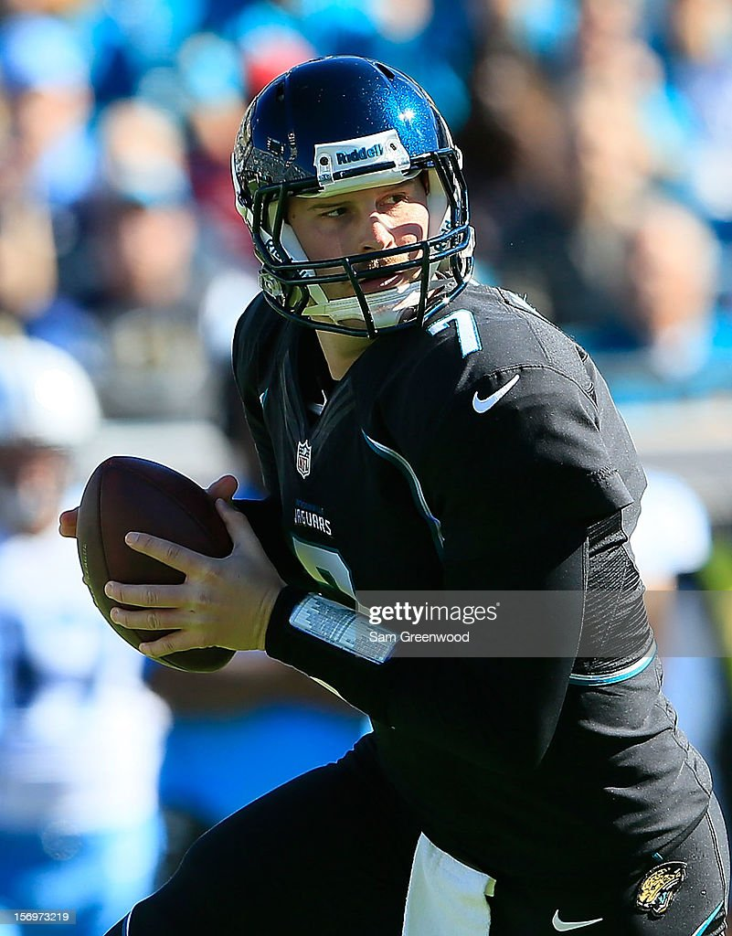 <a gi-track='captionPersonalityLinkClicked' href=/galleries/search?phrase=Chad+Henne&family=editorial&specificpeople=216361 ng-click='$event.stopPropagation()'>Chad Henne</a> #7 of the Jacksonville Jaguars scrambles for yardage during the game against the Tennessee Titans at EverBank Field on November 25, 2012 in Jacksonville, Florida.