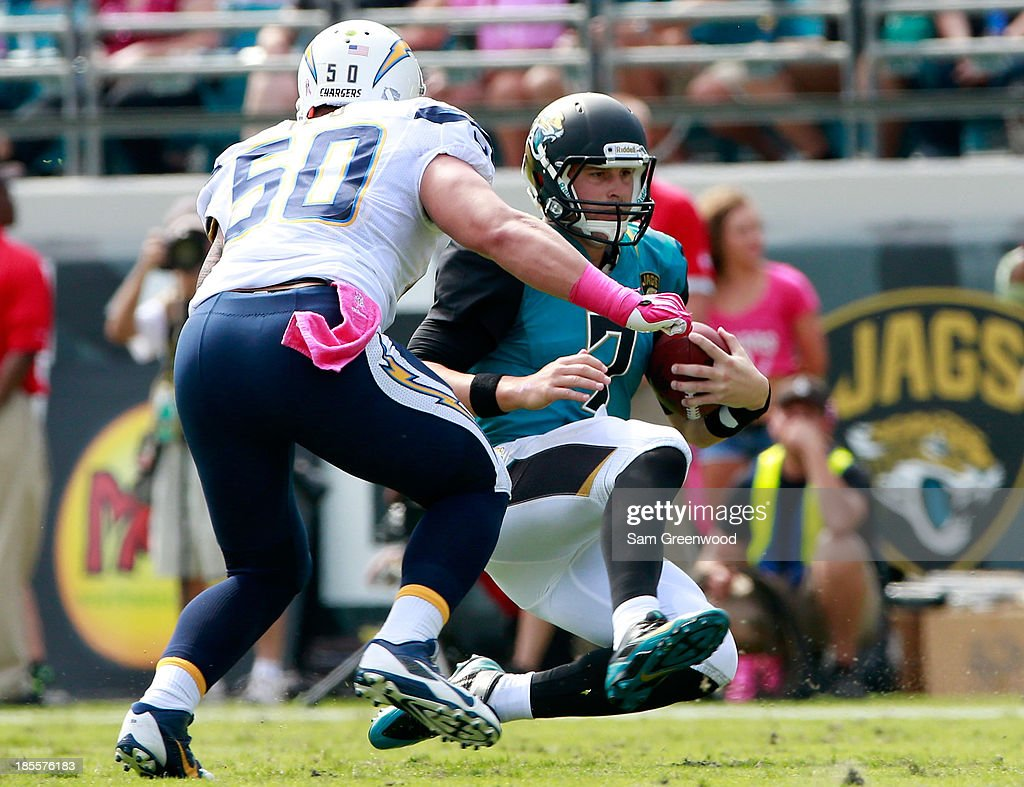 Chad Henne #7 of the Jacksonville Jaguars slides during the game against the San Diego Chargers at EverBank Field on October 20, 2013 in Jacksonville, Florida.