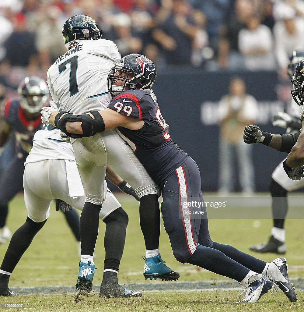 Chad Henne #7 of the Jacksonville Jaguars takes a hard hit from J.J. Watt #99 of the Houston Texans after releasing the ball at Reliant Stadium on November 18, 2012 in Houston, Texas. Houston wins 43-37 in overtime.