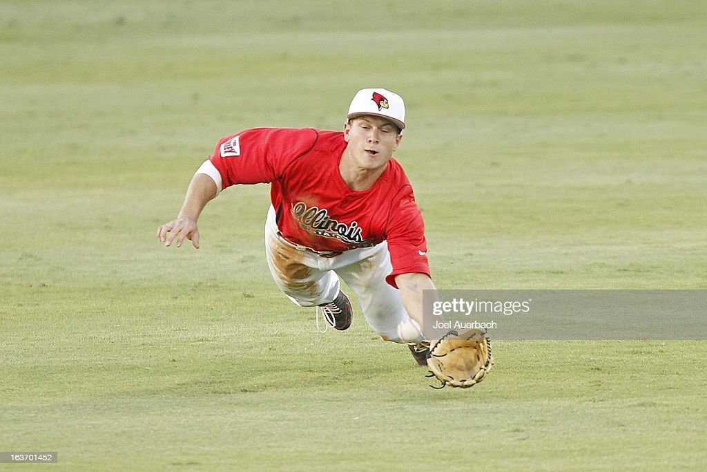 Chad Hinshaw #18 of the Illinois State Redbirds is unable to catch the ball hit by Christopher Barr #17 (not pictured) of the Miami Hurricanes in the fourth inning on March 13, 2013 at Alex Rodriguez Park at Mark Light Field in Coral Gables, Florida. The Hurricanes defeated the Redbirds 9-2.