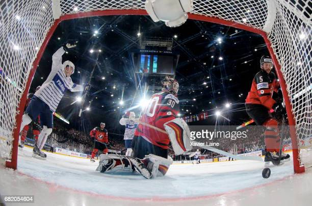 Chad Johnson of Canada reacts after a goal of Damien Fleury during the 2017 IIHF Ice Hockey World Championship game between Canada and France at...