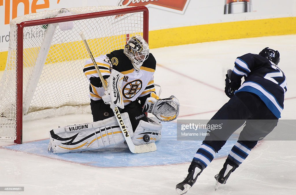 Chad Johnson #30 of the Boston Bruins blocks a shot on goal by <a gi-track='captionPersonalityLinkClicked' href=/galleries/search?phrase=Blake+Wheeler&family=editorial&specificpeople=716703 ng-click='$event.stopPropagation()'>Blake Wheeler</a> #26 of the Winnipeg Jets in third period action in an NHL game at the MTS Centre on April 10, 2014 in Winnipeg, Manitoba, Canada.