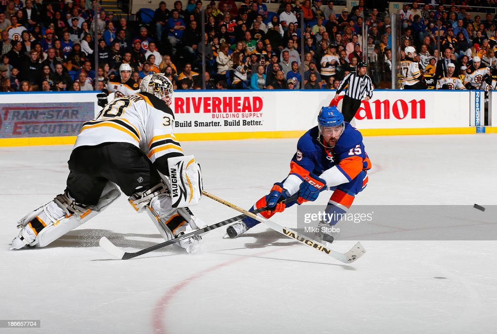 Chad Johnson #30 of the Boston Bruins defends against <a gi-track='captionPersonalityLinkClicked' href=/galleries/search?phrase=Cal+Clutterbuck&family=editorial&specificpeople=570497 ng-click='$event.stopPropagation()'>Cal Clutterbuck</a> #15 of the New York Islanders at Nassau Veterans Memorial Coliseum on November 2, 2013 in Uniondale, New York. The Islanders defeated the Bruins 3-1.