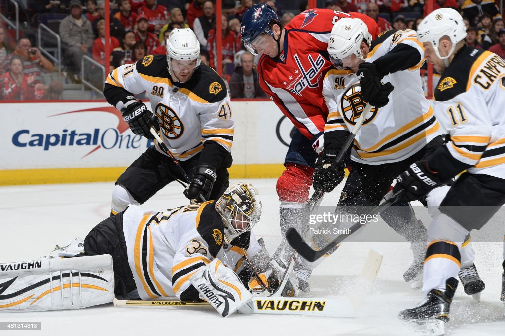 Chad Johnson #30 of the Boston Bruins makes a save against the Washington Capitals in the second period during an NHL game at Verizon Center on March 29, 2014 in Washington, DC.