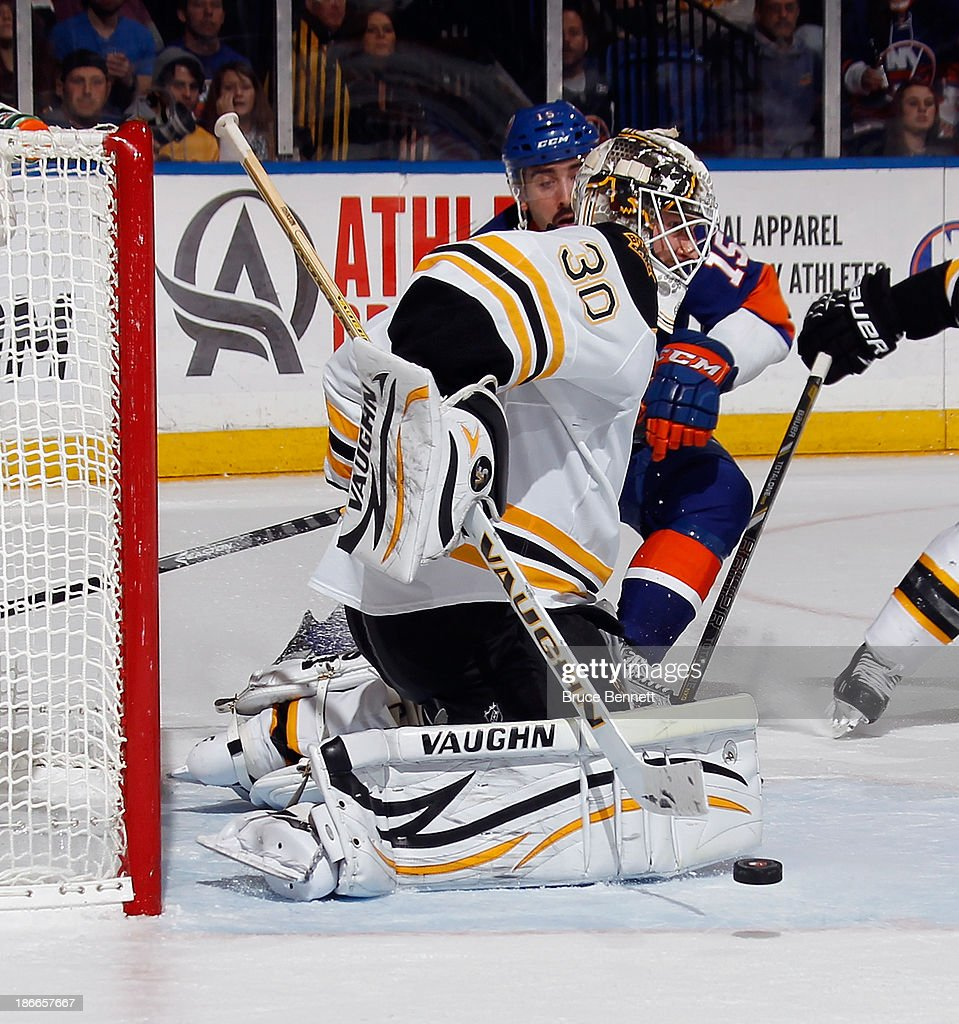 Chad Johnson #30 of the Boston Bruins makes the second period save against the New York Islanders at the Nassau Veterans Memorial Coliseum on November 2, 2013 in Uniondale, New York. The Islanders defeated the Boston Bruins 3-1.