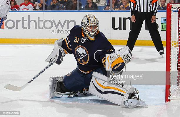 Chad Johnson of the Buffalo Sabres makes a glove save against the Montreal Canadiens during an NHL game on October 23 2015 at the First Niagara...