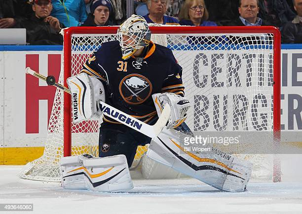 Chad Johnson of the Buffalo Sabres makes a second period save against the Toronto Maple Leafs during an NHL game on October 21 2015 at the First...