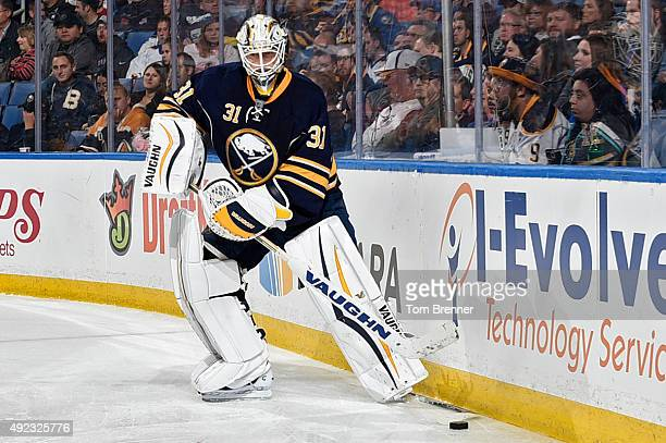 Chad Johnson of the Buffalo Sabres passes the puck during the game against the Ottawa Senators at the First Niagara Center on October 8 2015 in...