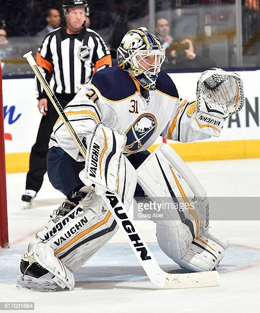 Chad Johnson of the Buffalo Sabres prepares for a shot against the Toronto Maple Leafs during game action on March 19 2016 at Air Canada Centre in...