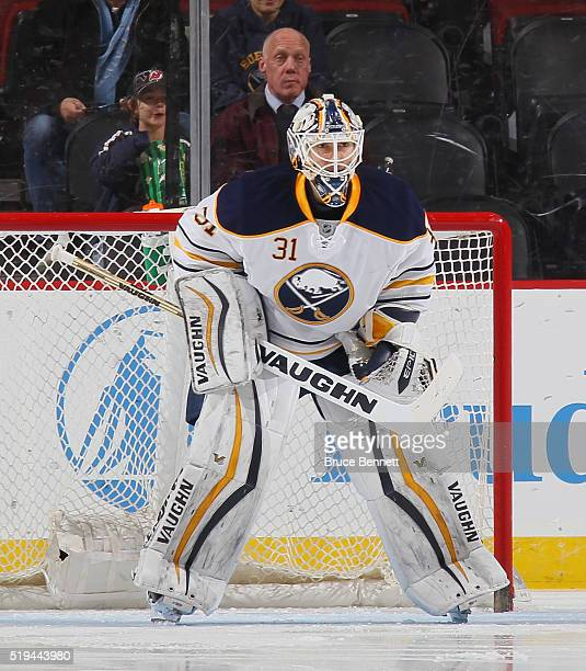 Chad Johnson of the Buffalo Sabres tends net against against the New Jersey Devils at the Prudential Center on April 5 2016 in Newark New Jersey The...