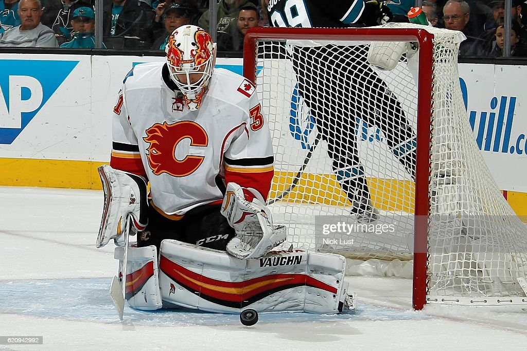 Chad Johnson #31 of the Calgary Flames blocks the puck during a NHL game against the San Jose Sharks at SAP Center at San Jose on November 3, 2016 in San Jose, California.