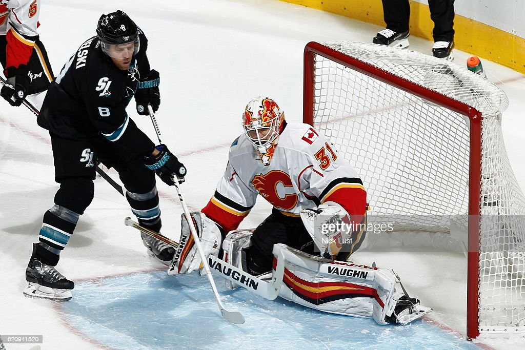 Chad Johnson #31 of the Calgary Flames defends the net against Joe Pavelski #8 of the San Jose Sharks during a NHL game at SAP Center at San Jose on November 3, 2016 in San Jose, California.