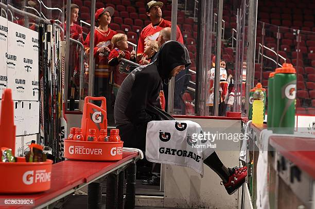 Chad Johnson of the Calgary Flames sits on the bench and prepares for a game against the Arizona Coyotes at Gila River Arena on December 8 2016 in...
