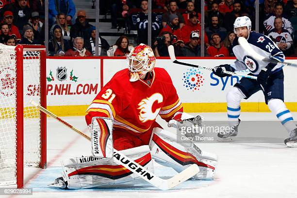 Chad Johnson of the Calgary Flames skates against the Winnipeg Jets during an NHL game on December 10 2016 at the Scotiabank Saddledome in Calgary...