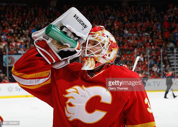 Chad Johnson of the Calgary Flames stays hydrated against the Vancouver Canucks at Scotiabank Saddledome on January 7 2017 in Calgary Alberta Canada