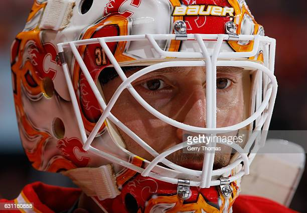 Chad Johnson of the Calgary Flames takes a moment at the bench against the Vancouver Canucks at Scotiabank Saddledome on January 7 2017 in Calgary...