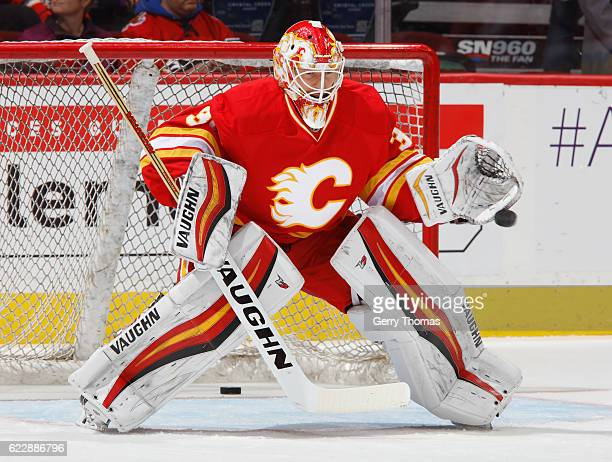 Chad Johnson of the Calgary Flames takes shots in warm up prior to the game against the New York Rangers at Scotiabank Saddledome on November 12 2016...