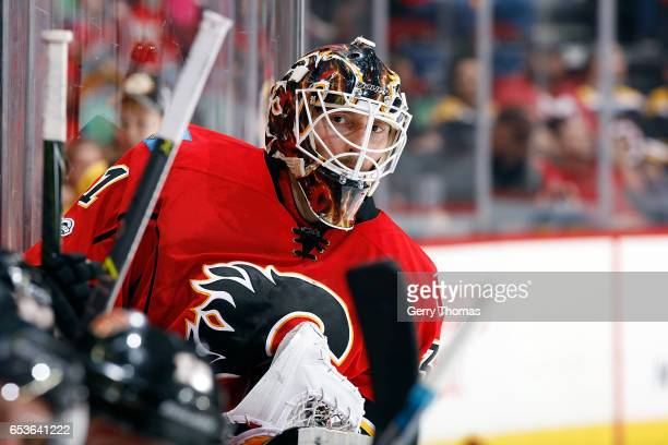 Chad Johnson of the Calgary Flames waits on the bench during an NHL game against the Boston Bruins on March 15 2017 at the Scotiabank Saddledome in...