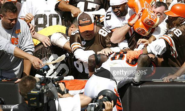 Chad Johnson of the Cincinnati Bengals gets a beer thrown on him after celebrating a toucdown by jumping into the legendary Cleveland Browns dog...