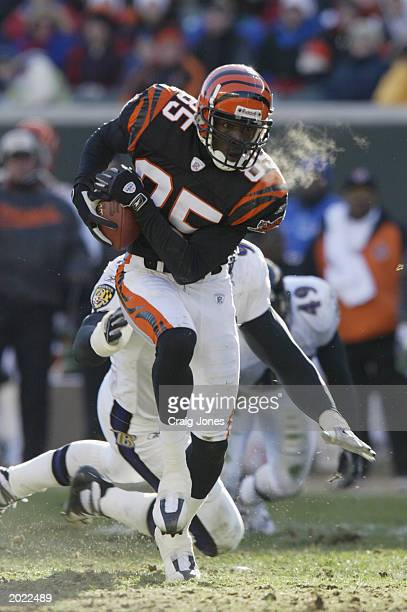 Chad Johnson of the Cincinnati Bengals is chased by Adalius Thomas of the Baltimore Ravens on December 1 2002 at Paul Brown Stadium in Cincinnati...