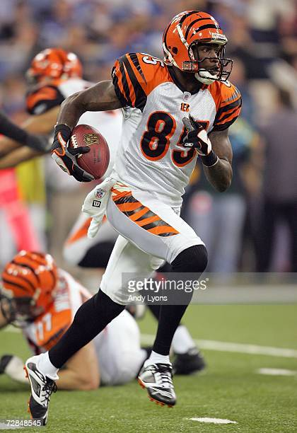 Chad Johnson of the Cincinnati Bengals runs with the ball against the Indianapolis Colts during the NFL game at the RCA Dome December 18 2006 in...