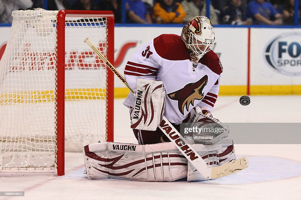 Chad Johnson #31 of the Phoenix Coyotes makes a save against the St. Louis Blues in the third period at the Scottrade Center on April 18, 2013 in St. Louis, Missouri. The Blues beat the Coyotes 2-1 in a shootout.