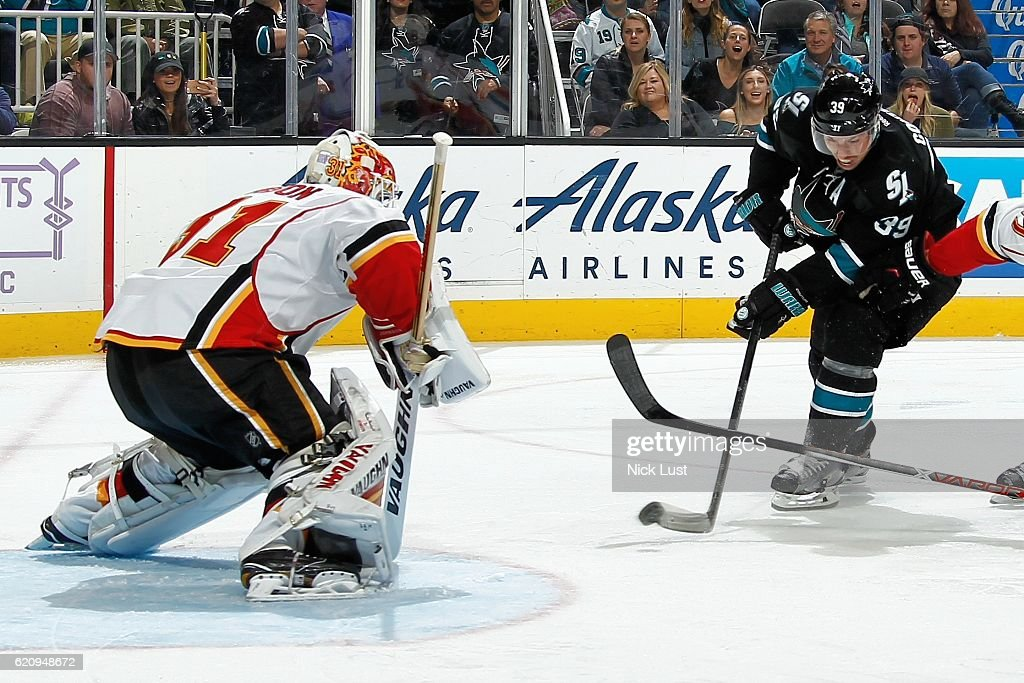 Chad Johnson #31of the Calgary Flames defends the net against Logan Couture #39 of the San Jose Sharks during a NHL game at SAP Center at San Jose on November 3, 2016 in San Jose, California.