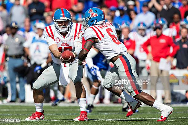 Chad Kelly hands off the ball to Jaylen Walton of the Ole Miss Rebels during a game against the Memphis Tigers at Liberty Bowl Memorial Stadium on...