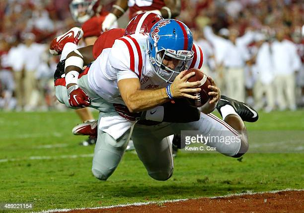 Chad Kelly of the Mississippi Rebels dives for a touchdown against Shaun Hamilton of the Alabama Crimson Tide at BryantDenny Stadium on September 19...