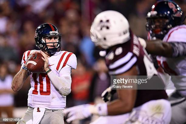 Chad Kelly of the Mississippi Rebels drops back to pass during a game against the Mississippi State Bulldogs at Davis Wade Stadium on November 28...