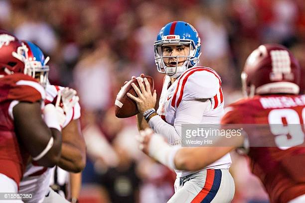 Chad Kelly of the Mississippi Rebels drops back to pass during a game against the Arkansas Razorbacks at Razorback Stadium on October 15 2016 in...
