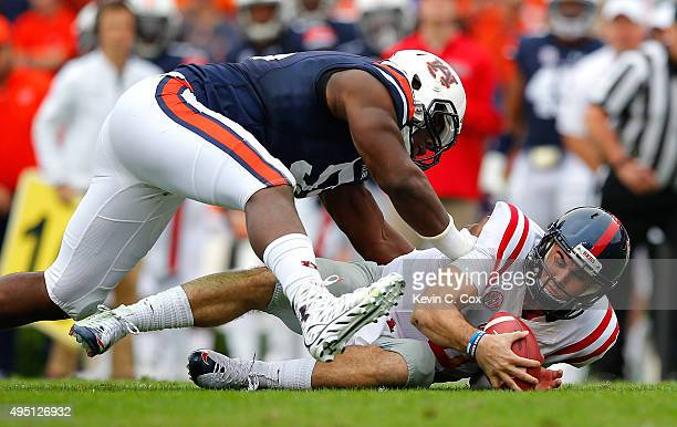 Chad Kelly of the Mississippi Rebels jumps on his fumble as he is tackled by Carl Lawson of the Auburn Tigers at JordanHare Stadium on October 31...