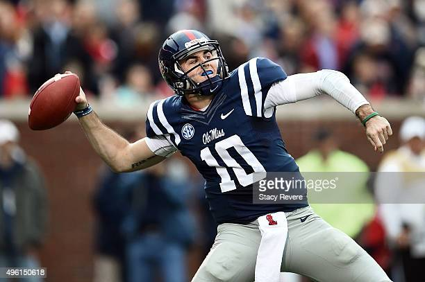 Chad Kelly of the Mississippi Rebels looks to pass during the second quarter of a game against the Arkansas Razorbacks at VaughtHemingway Stadium on...