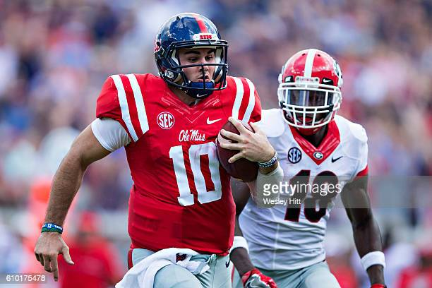 Chad Kelly of the Mississippi Rebels runs for a touchdown against Deandre Baker of the Georgia Bulldogs at VaughtHemingway Stadium on September 24...