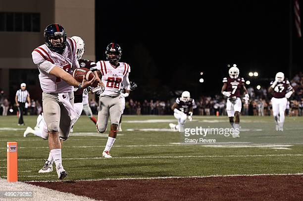 Chad Kelly of the Mississippi Rebels rushes for a touchdown during the first quarter of a game against the Mississippi State Bulldogs at Davis Wade...