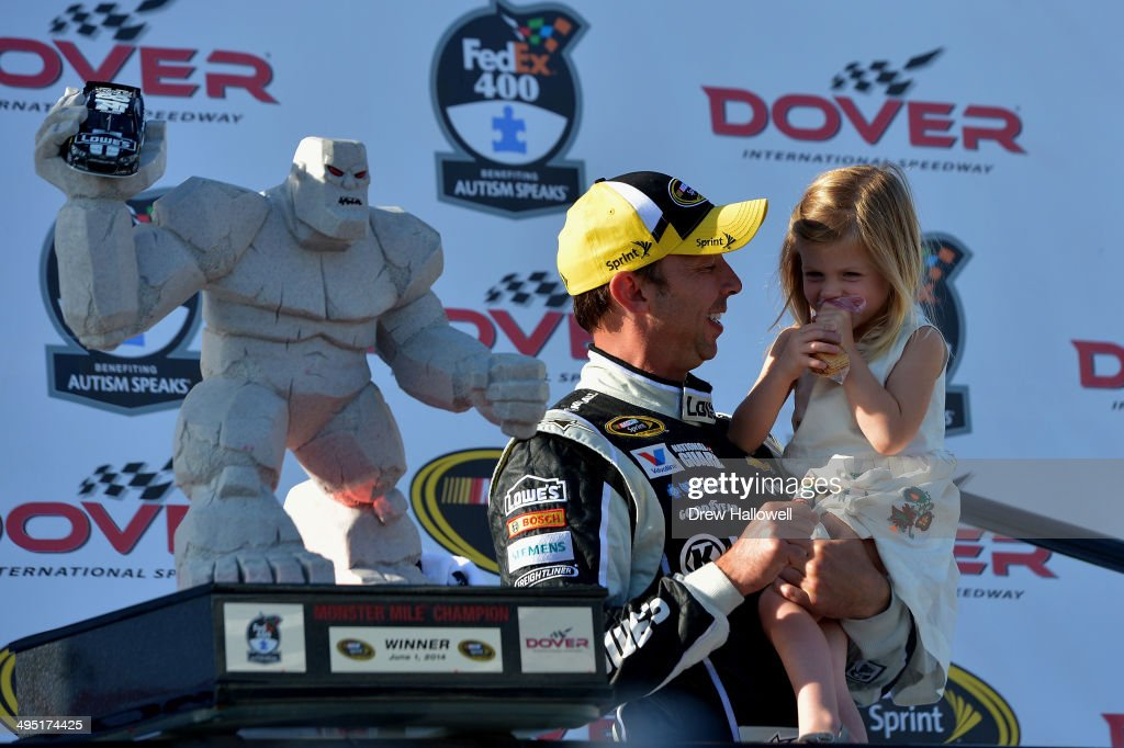 Chad Knaus, crew chief for Jimmie Johnson, driver of the #48 Lowe's/Kobalt Tools Chevrolet, holds Johnson's daughter Genevieve in Victory Lane after winning the NASCAR Sprint Cup Series FedEx 400 Benefiting Autism Speaks at Dover International Speedway on June 1, 2014 in Dover, Delaware.