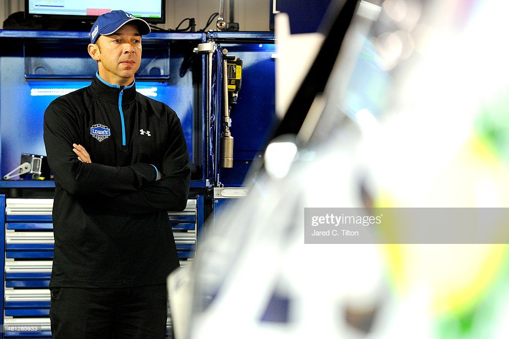 Chad Knaus, crew chief of the #48 Lowe's Chevrolet, looks on in the garage area during a rain delay in practice for the NASCAR Sprint Cup Series STP 500 at Martinsville Speedway on March 29, 2014 in Martinsville, Virginia.