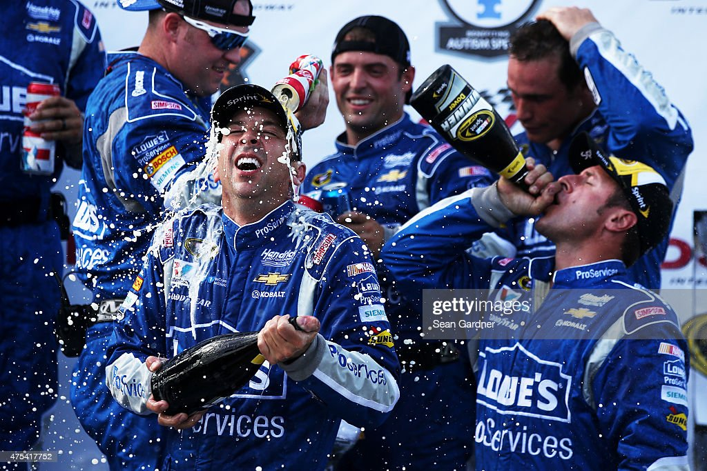 <a gi-track='captionPersonalityLinkClicked' href=/galleries/search?phrase=Chad+Knaus&family=editorial&specificpeople=564401 ng-click='$event.stopPropagation()'>Chad Knaus</a>, crew chief of the #48 Lowe's Pro Services Chevrolet, bottom left, is sprayed with champagne and beer in Victory Lane after winning the NASCAR Sprint Cup Series FedEx 400 Benefiting Autism Speaks at Dover International Speedway on May 31, 2015 in Dover, Delaware.