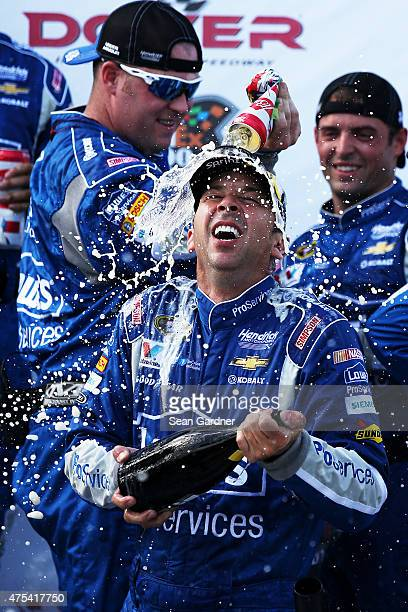 Chad Knaus crew chief of the Lowe's Pro Services Chevrolet front is sprayed with champagne and beer in Victory Lane after winning the NASCAR Sprint...