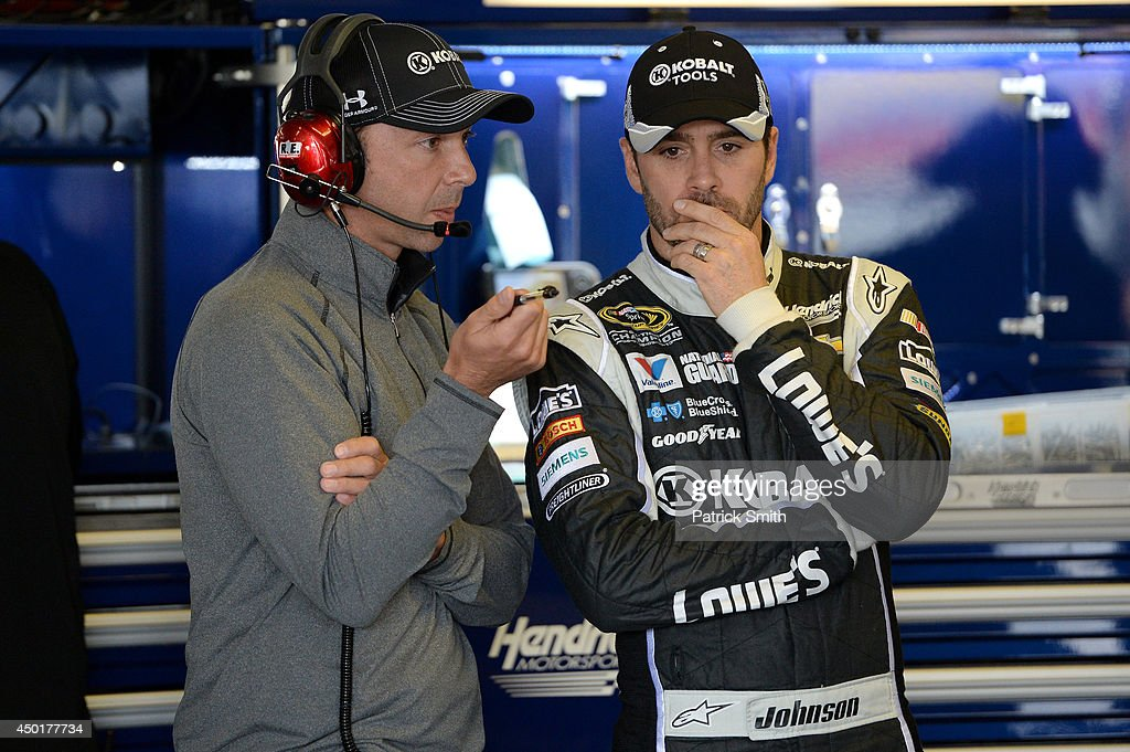 Chad Knaus (left), crew chief of the #48 Lowe's/Kobalt Tools Chevrolet, talks with Jimmie Johnson, driver of the #48 Lowe's/Kobalt Tools Chevrolet (not pictured), in the garage area during practice for the NASCAR Sprint Cup Series Pocono 400 at Pocono Raceway on June 6, 2014 in Long Pond, Pennsylvania.