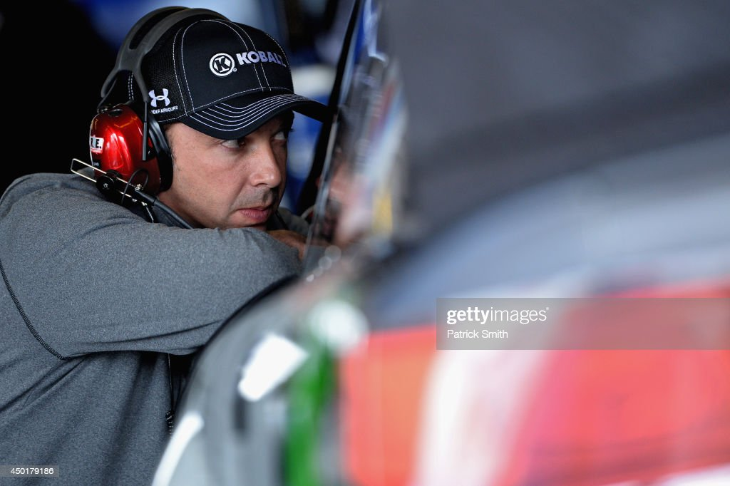 Chad Knaus, crew chief of the #48 Lowe's/Kobalt Tools Chevrolet, talks with Jimmie Johnson, driver of the #48 Lowe's/Kobalt Tools Chevrolet (not pictured), in the garage area during practice for the NASCAR Sprint Cup Series Pocono 400 at Pocono Raceway on June 6, 2014 in Long Pond, Pennsylvania.