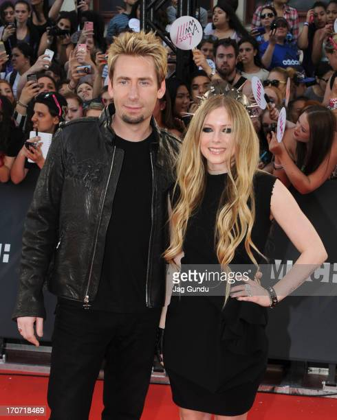 Chad Kroeger and Avril Lavigne arrive on the red carpet at the 2013 MuchMusic Video Awards at Bell Media Headquarters on June 16 2013 in Toronto...