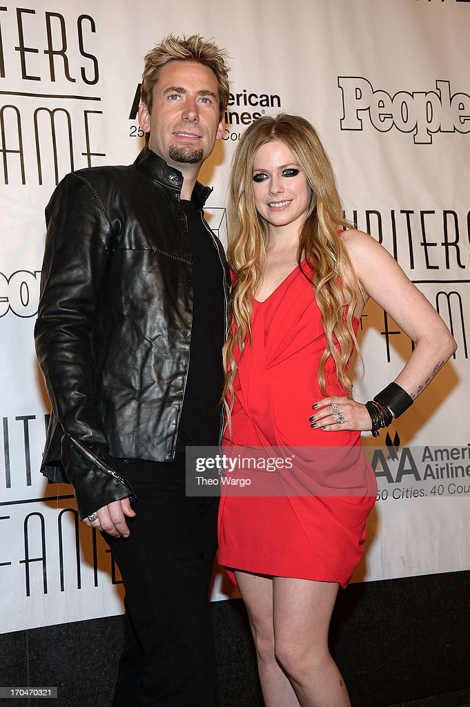 <a gi-track='captionPersonalityLinkClicked' href=/galleries/search?phrase=Chad+Kroeger&family=editorial&specificpeople=193804 ng-click='$event.stopPropagation()'>Chad Kroeger</a> (L) and <a gi-track='captionPersonalityLinkClicked' href=/galleries/search?phrase=Avril+Lavigne&family=editorial&specificpeople=171190 ng-click='$event.stopPropagation()'>Avril Lavigne</a> attend the Songwriters Hall of Fame 44th Annual Induction and Awards Dinner at the New York Marriott Marquis on June 13, 2013 in New York City.