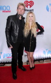 Chad Kroeger and Avril Lavigne attend Y100's Jingle Ball 2013 Presented by Jam Audio Collection at BBT Center on December 20 2013 in Miami Florida
