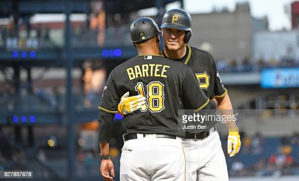 Chad Kuhl of the Pittsburgh Pirates hugs first base coach Kimera Bartee after recording his first RBI on a single in the fourth inning during the...