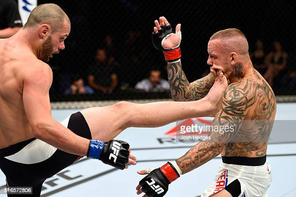 Chad Laprise of Canada lands a front kick to the face of Ross Pearson of England in their lightweight bout during the UFC Fight Night event at the...