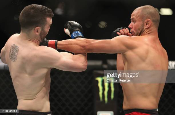 Chad Laprise of Canada punches Brian Camozzi in their welterweight bout during the UFC 213 event at TMobile Arena on July 8 2017 in Las Vegas Nevada