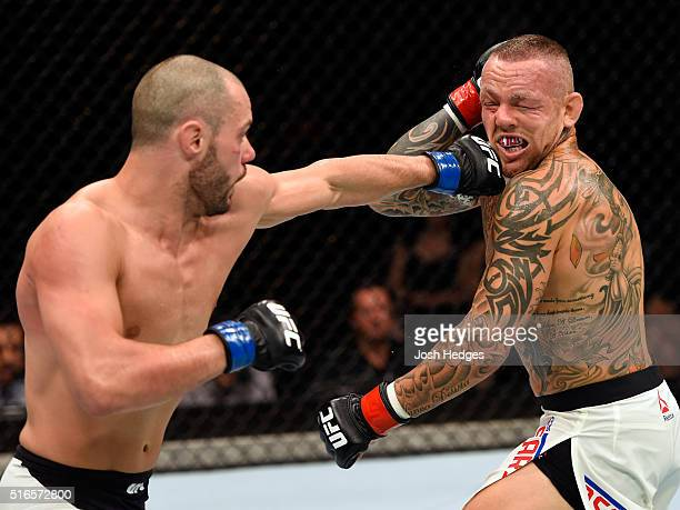 Chad Laprise of Canada punches Ross Pearson of England in their lightweight bout during the UFC Fight Night event at the Brisbane Entertainment...