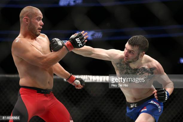 Chad Laprise punches Brian Camozzi in their welterweight bout during the UFC 213 event at TMobile Arena on July 9 2017 in Las Vegas Nevada