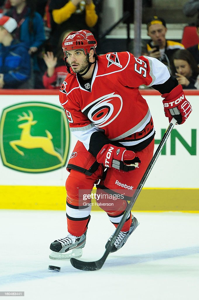 Chad LaRose #59 of the Carolina Hurricanes against the Boston Bruins during play at PNC Arena on January 28, 2013 in Raleigh, North Carolina. The Bruins defeated the Hurricanes 5-3.